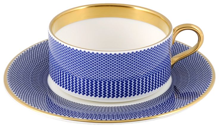Elegant Teacup & Saucer taken from the 'Benday Cobalt' range, hand finished with 22kt Gold gilding. Hand made in Stoke-on-Trent, England. A collection that is inspired by Benjamin Day: 'our homage to the dot'. Handwash Only, Fine Bone China. Find out more here: https://thenewenglish.co.uk/collections/benday-cobalt #TheNewEnglish #Benday #Cobalt
