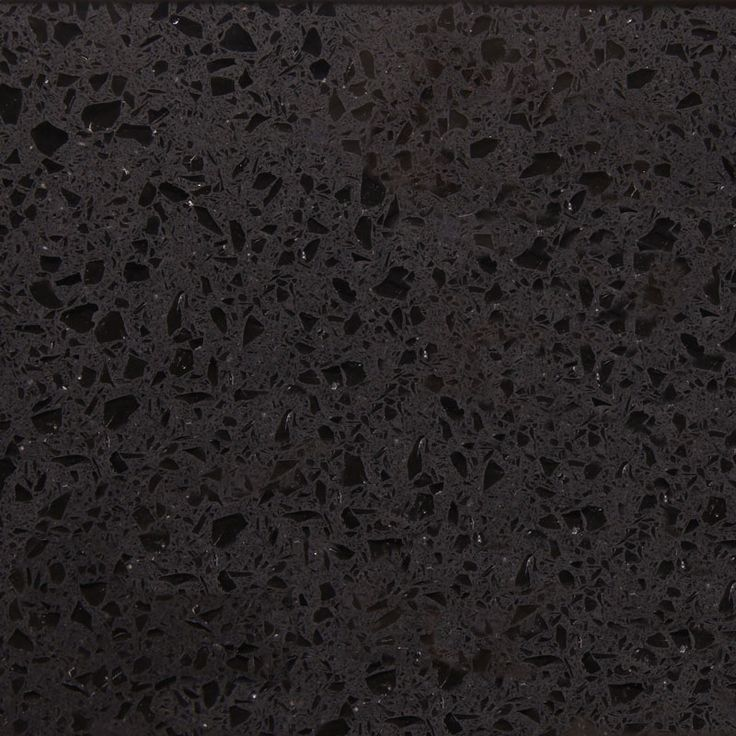 This is Cosmico Nero- It is a very popular black style quartz with mirrored speckles throughout.