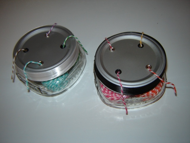 Here are the tops of the twine holder mason jars. I used the crop-o-dile to punch holes then used eyelets to create a smooth opening for the twine to easily pull thru.