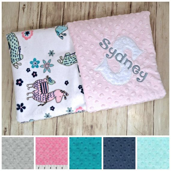 This listing is for 1 Minky Baby Blanket: Pink, Teal, Aqua, Gray and Mint Llama print minky on one side and Pink Minky Dot on the other. This blanket is approx. 29 x 35. It is Perfect for a crib, car seat or stroller. Blankets are zigzag topstitched to increase stability and wear. Each blanket comes wrapped in a satin ribbon with a tag containing care instructions. ***You have the option to PERSONALIZE the time of purchase. At checkout, please leave the following info in the notes to seller…