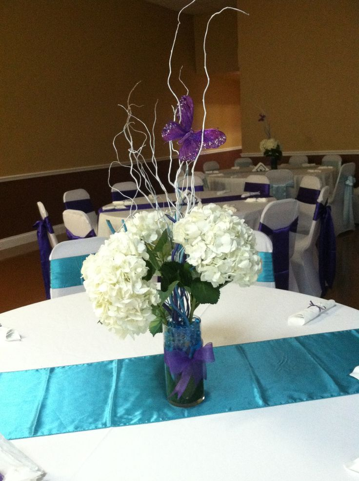 My centerpieces for a quinceañera party using white