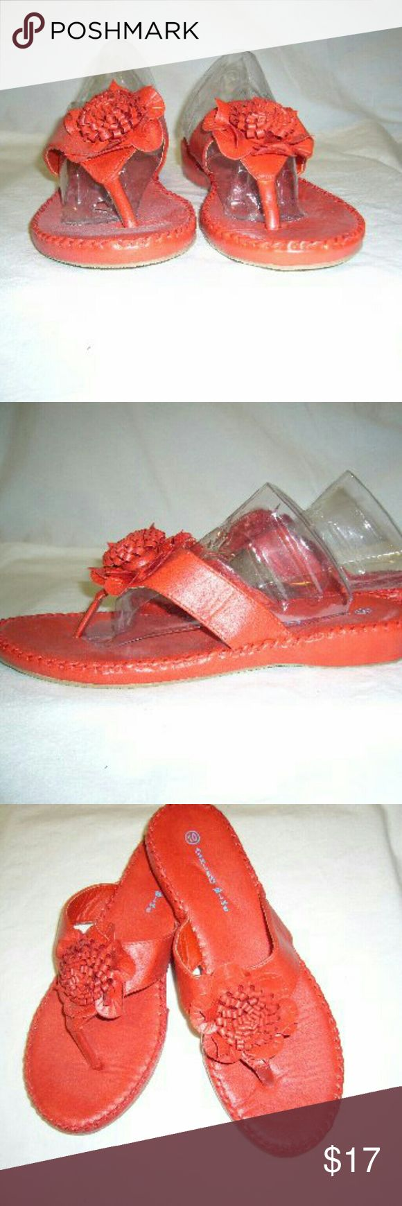 Red Flower Bow Sandals/Slides These adorable slides have hand-stitching all the way around top of the foot bed. Faux leather material. Cute detail in the flower that sits atop the straps. Straps are approximate 1 inch wide with rubber like soles. Strap that goes between the toes is wrapped in clear vinyl it doesn't irritate your toes. Shoes are approximate one inch I never worn brand new. Ashley Blue Shoes Sandals