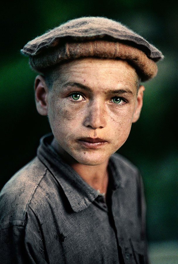 So young but so much pain in his face, sad :( Nuristan Province, Afghanistan. Steve McCurry