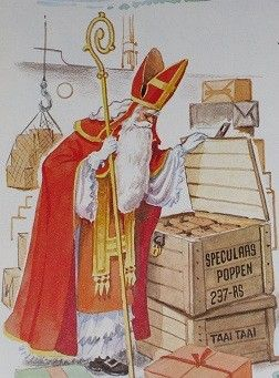Sinterklaas kijkt aandachtig naar de goed gevulde kisten met speculaaspoppen!