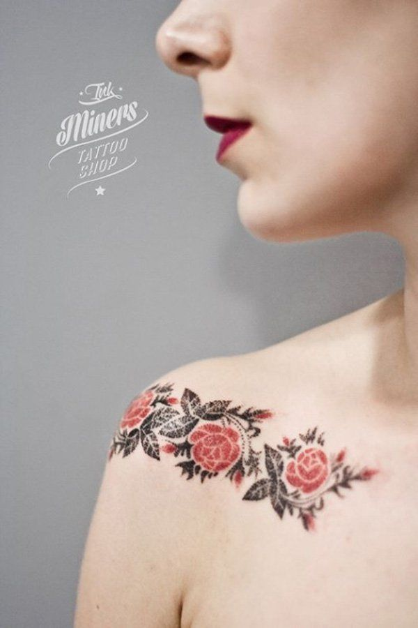Beautiful rose tattoo covering from shoulder to collarbone.