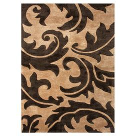 Hand-tufted rug made with a wool and art silk blend.  Product: RugConstruction Material: Wool and art silk blendColor: Tan and deep charcoalFeatures:  Plush pileTexturedHand-tufted Note: Please be aware that actual colors may vary from those shown on your screen.