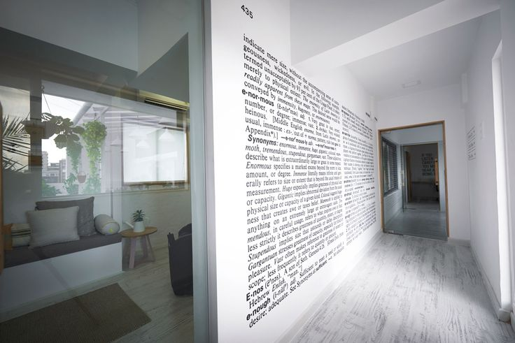 """In the studio of Enormous, a Mumbai-based advertising agency - A vinyl print with the dictionary meaning of the word, """"enormous"""" extends across the length of the wall. Image courtesy, Inner I Design"""