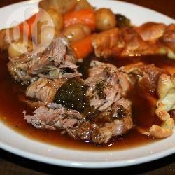 3 carrots, peeled and cut into chunks 12 small new potatoes about 700g boneless lamb shoulder joint salt and pepper 400ml lamb stock (I used a stock cube) 2 tablespoons Bisto® gravy granules