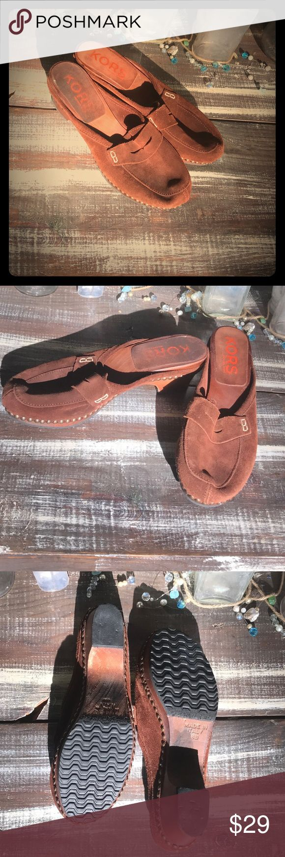 Michael Kors Wooden Heel Clogs 8B Michael Kors Clogs with wooden heel and Suede Upper. Super Cute and well loved. Lots of life left from a smoke free home. Size 8B. KORS Michael Kors Shoes Mules & Clogs