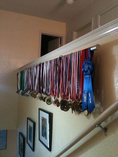 Medals display with curtain rod, this would be great for my little track star's bedroom!