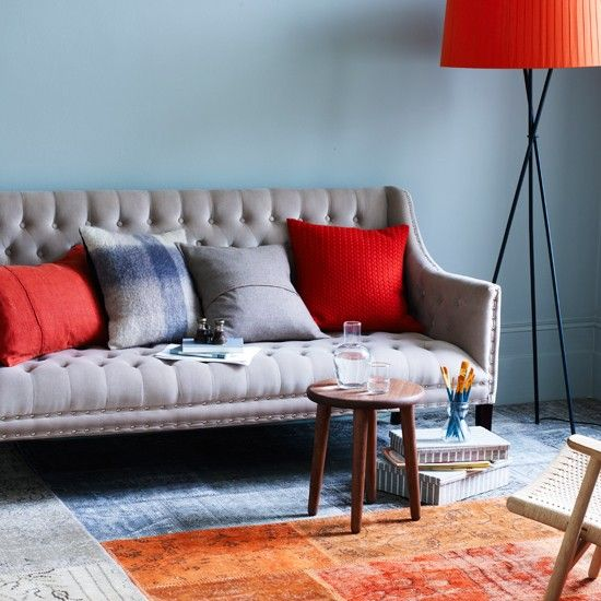 Blue And Orange Living Room With Tapestry Rug