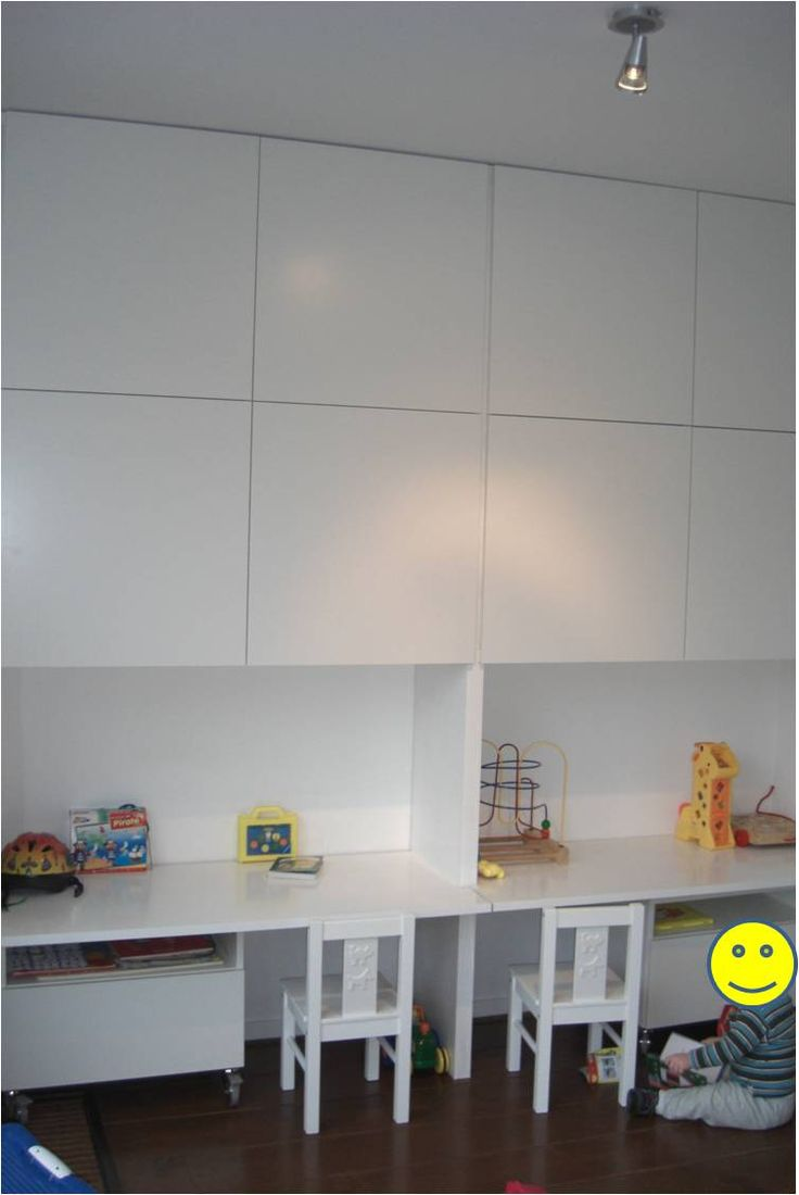 Materials: 2 BESTÅ units with 6 shelfs, 2 BESTÅ units with 1shelf, 2 drawers with front, 4 sets of large BESTÅ castors, 8 square doors, all white. Two MDF wooden plates, white paint, screwdrivers, screws, saw and lots of glue. Two white KRITTER chairs. Description: In our L-shaped living room, we wanted our small kids [&hellip