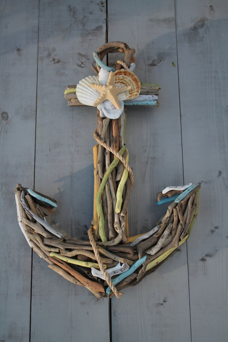 Driftwood Anchor with Seashells. I like how they stained the driftwood other colors...the anchor doesn't matter so much.