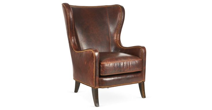 Feb 17, 2020 - Upholstered in sumptuous leather, this wingback chair will bring a quiet stateliness to any setting. Gleaming nail-head trim accentuates the classic silhouette. Handcrafted in Dallas, Texas.Seating...