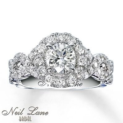 Take her breath away with this Neil Lane Bridal engagement ring featuring a halo of stunning round diamonds.
