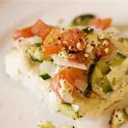 An Italian-style vegetable and feta cheese topping is the perfect enhancement to delicious baked halibut.