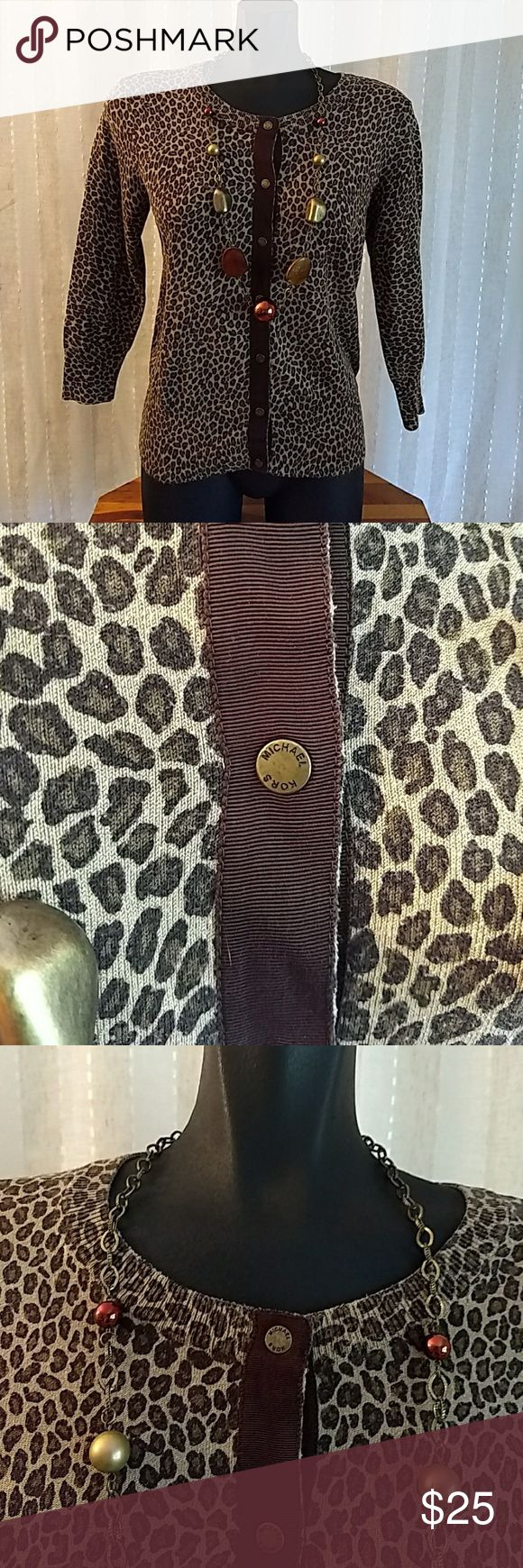 Michael Kors cheetah cardigan Size small, moderately loved around the neck picture above, cheetah print in Design, button front closure, 3/4 quarter inch sleeves Michael Kors Sweaters Cardigans