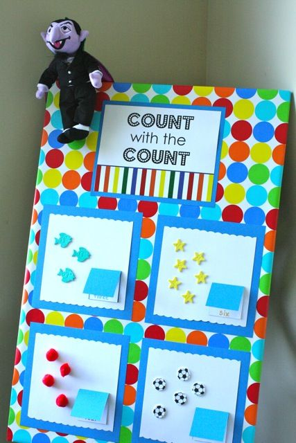 """Counting board made with wrapping paper & stickers - count the various shapes & look under the flap to see the answer ("""",)"""