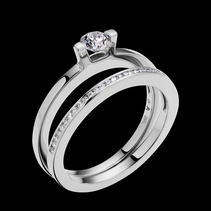 """Delicia"" showcases the brilliance of a solitaire diamond. This ring has a 0.25 carat round brilliant center diamond."