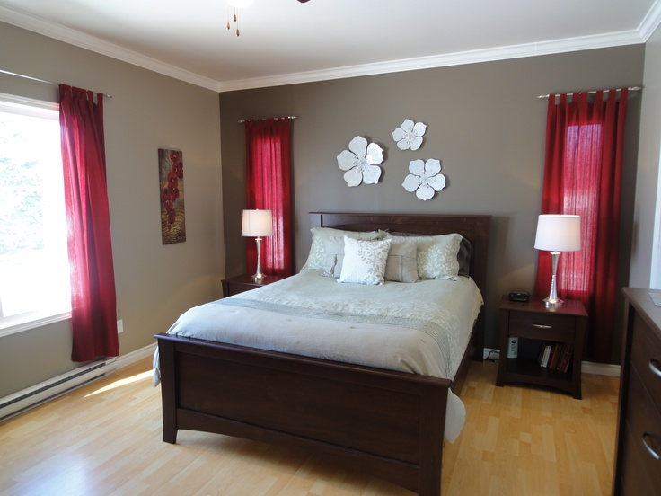I just decorated our guest bedroom with red accents. I would love to paint the white walls this color :)