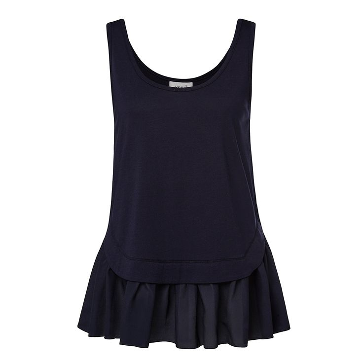 Cotton/Modal Peplum Tank. Comfortable yet neat fitting sleeveless tank features a low scoop neck, slightly fitted body with contrasting peplum hem. Available in Ink Blue as shown.