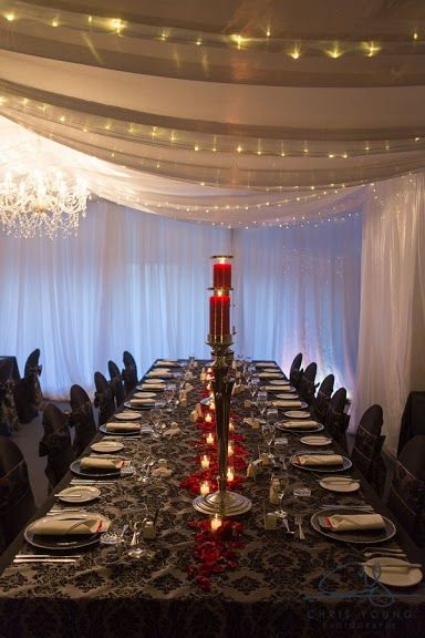 Wedding table arrangements, Wedding table long, red wedding table candles, black elegant wedding table covers -Tamar Valley Resort
