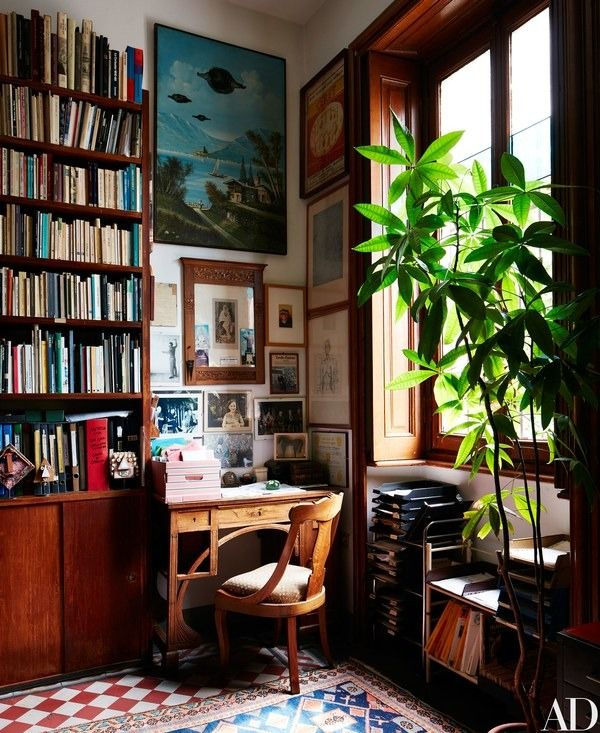 An Art Nouveau desk is tucked into a corner of the library   archdigest.com