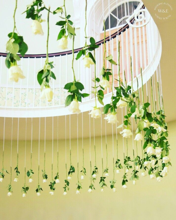 Beautiful White Rose Flower Curtain on the magnificent staircase at Middleton Lodge  www.weddingandevents.co.uk