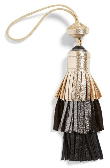 Gold or burgundy..... Vince Camuto Tiered Leather Tassel Bag Charm at Nordstrom.com. Tiered, tri-tone fringe defines a flouncy leather bag charm that adds flirty movement with every step.