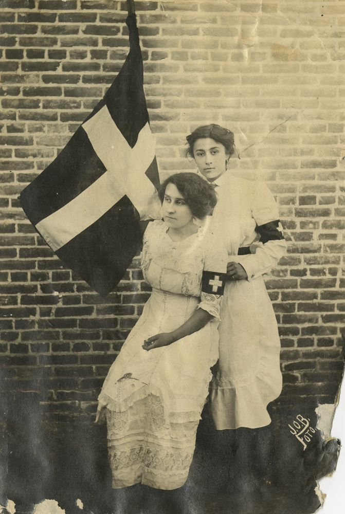 """Leonor Villegas de Magnón with Aracelito Garcia, 1914. Leonor earned five medals in the Mexican Revolution - most remarkable since most of her service was north of the Rio Grande. She was teaching in Laredo, Texas when the turmoil of the revolution butted against the border. She crossed back and forth to care for the wounded, and converted her home into a makeshift hospital. She attracted women volunteers into """"La Cruz Blanca"""" who gave medical help regardless of political leanings."""