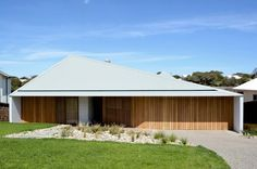 vibe design group covers house in melbourne with asymmetric steel roof