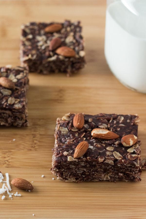 Almonds, coconut & chocolate come together in these delicious Almond Joy Granola Bars. Wholesome ingredients, gluten-free, vegan & totally addictive!: