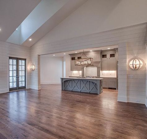 A living room full of ship lap, natural light and a view of the custom island apron from a recently completed project!! #chandelierdevelopment #shiplap #naturallightEmily Ingram