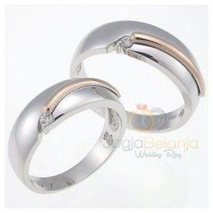 Cincin sepasang menjadi item yang tak boleh terlewat untuk sebuah moment sakral seperti pernikahan. Pemilihan desain yang sesuai selera menjadi hal yang diutamakan. Cincin Pernikahan Tarizka kami hadirkan sebagai solusi pilihan cincin pernikahan anda. Desain cincin tersusun dari bentuk cincin yang seolah-olah saling bertautan mengisi celah yang pas. Pada celah tersebut dihias lilitan bahan yang …