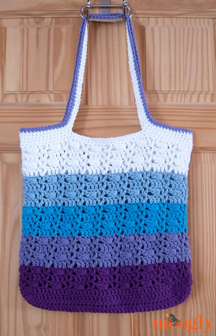 Wrapped Ombre Tote Bag. Free Crochet Pattern......  A combination of wrapped stitches and V stitches, with some fun stripes, keeps this bag moving and fun to make.