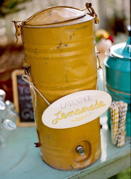 Lemonade, iced tea and water for guests when they arrive - I like the eclectic containers.