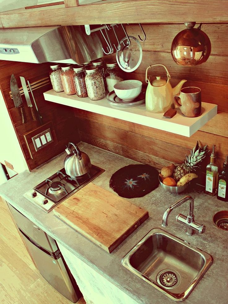 Use of wood, metal and white in kitchen:  Leaf House trailer