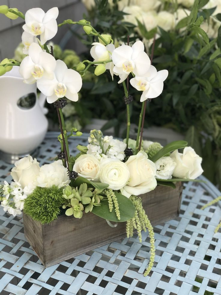 Rustic Garden Centerpiece with orchids and roses