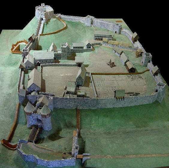 A reconstruction of Carisbrooke Castle in England during the 14th century...I like that they are small towns: