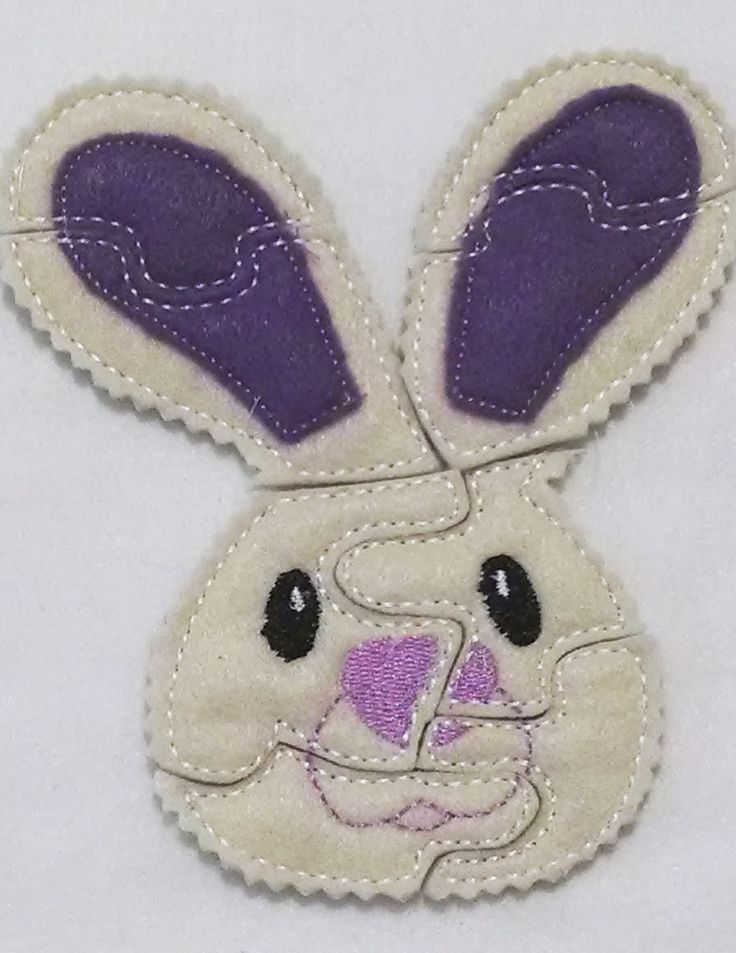 """Bunny with purple ears felt puzzle. Bunny puzzle measures approx. 5""""X7"""" We have a lot of other puzzles in the store and they are all double sided which means there is one color felt on one side and an"""
