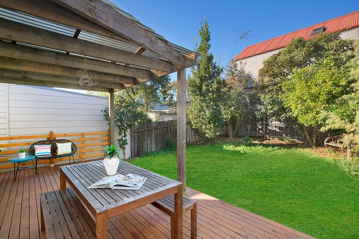 Large wide-fronted semi, covered BBQ deck, private garden, level lawn, outdoor setting, Pilcher Residential