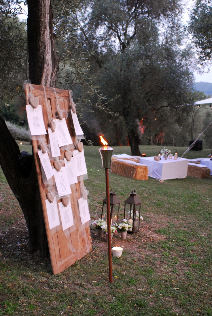 Olive trees, straw bales, torches, flower pots and a calligraphed table plan are a perfect combination for a provencal wedding    #handwritten #calligraphy #tableplan #provencal #wedding