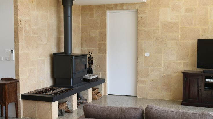 Winter comforts. Limestone has an amazing thermal properties very suitable for fireplace surrounds. WA Biscuit mic length tile.