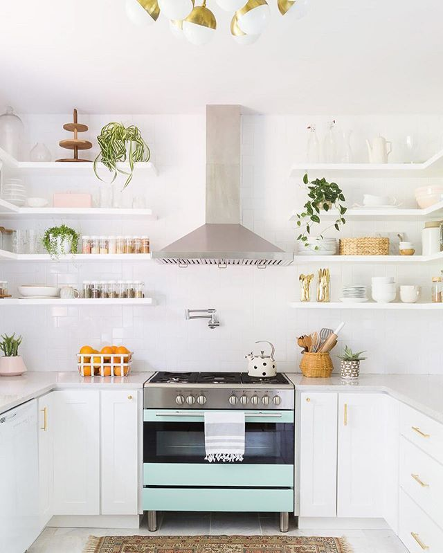 #MyDomaineTIPS: What's one way you can keep your kitchen über organized? House items you use most often—salt, pepper, olive oil—in an accessible place, like in the room above. In need of more organization tips? Tap the link in our bio. | photo: @alyssarosenheck for @dominomag; design: @abeautifulmess