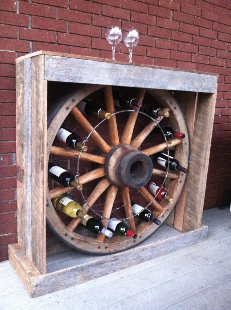 Awesome wine rack made from tennessee wood flooring for Diy wagon wheel