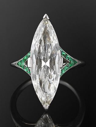 Art Deco marquise diamond and emerald ring.The marquise shape was popular in the 1970s as well and may be poised for a comeback..it can comeback here.