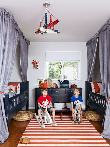 We can't decide our favorite part of this room — the model airplane light fixture or the makeshift curtain bed forts?!