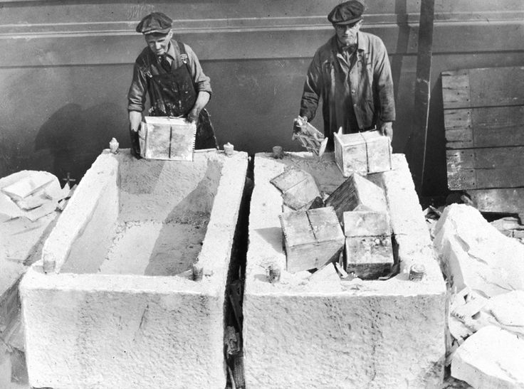 Workers in Brooklyn unload cases of liquor from marble blocks, which were used to conceal alcohol before the repeal of Prohibition, in October 1933.