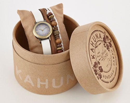 Stylish Ladies' Kahuna splash proof quartz watch, with white leather strap and stacked bracelets, presented in a cool box.  Internet special - not available in our catalogues.  With 2 Year Guarantee