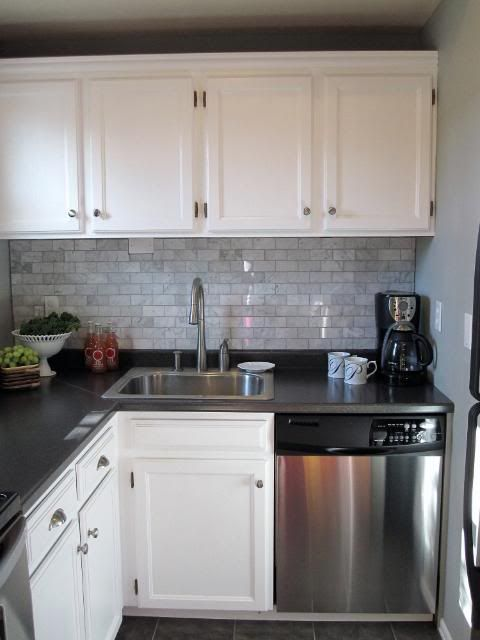 Source Freckles Beautiful Kitchen With Cabinets Painted Behr Ultra White Marble Tiles Backsaplsh And Black Laminate Countertops